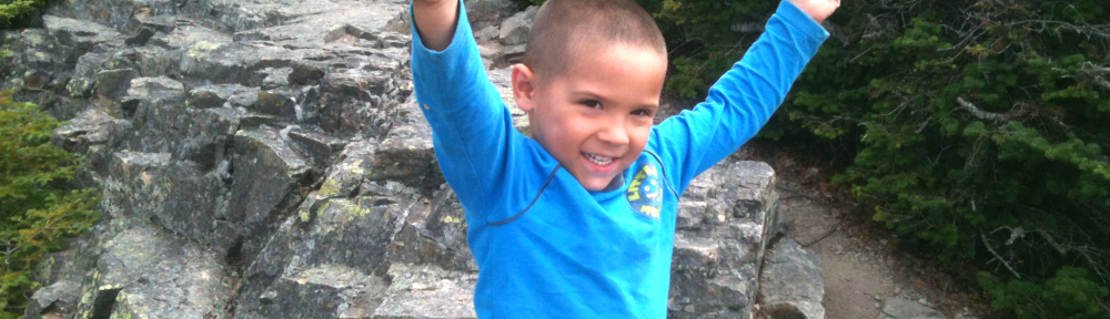 Connor celebrates on Mt. Flume