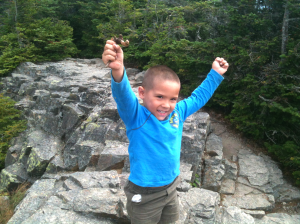 Connor celebrates on Mt. Flume