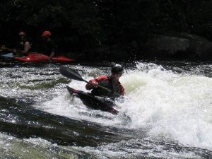 Tom in a whitewater kayak